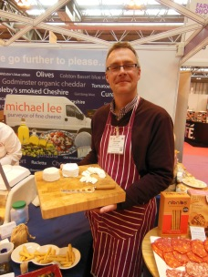 Phil Hulland displaying his wonderful Capria goats cheese.