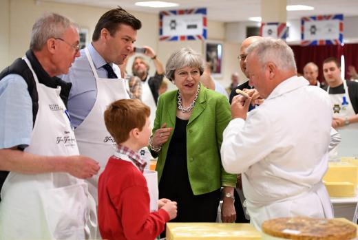 Britain's Prime Minister Theresa May samples cheese at the Royal Bath and West Show in Shepton Mallet